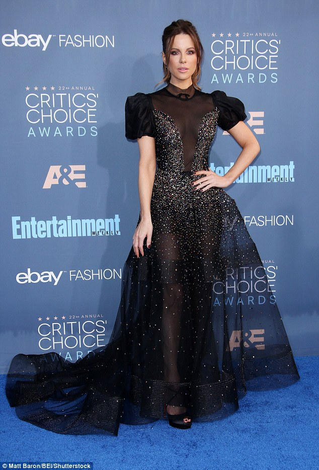 All eyes on her: Kate Beckinsale ensured she was the centre of attention on Sunday night as she made a show-stopping arrival at the 22nd Critic's Choice Awards. The Van Helsing star looked truly mesmerising in the floor-length gown, which was formed entirely of black mesh to reveal her long legs and killer figure
