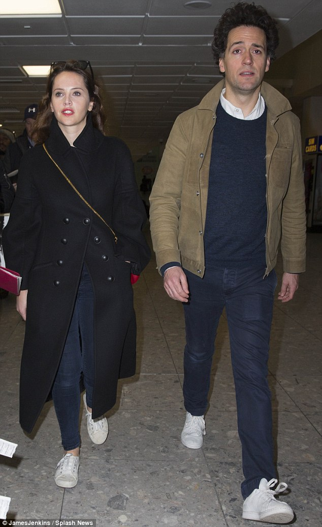 Just landed:But Felicity Jones and director boyfriend Charles Guard sported casual looks as they made their way through Heathrow ahead of the London premier of Rogue One on Monday