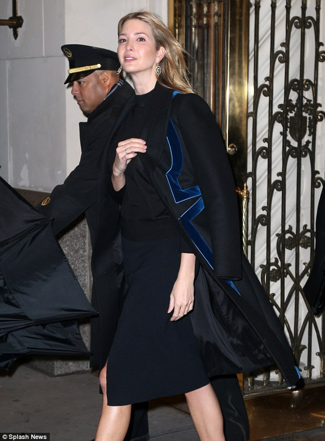Keeping warm: The future-First Daughter wore an elegant black and velvet-trimmed coat around her shoulders as she braved the rainy New York City weather