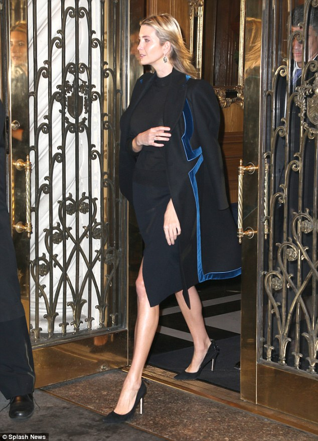 Always stylish: The 35-year-old mom donned a black top, a navy skirt with a slit, and black pumps, opting to keep her legs bare despite the chill