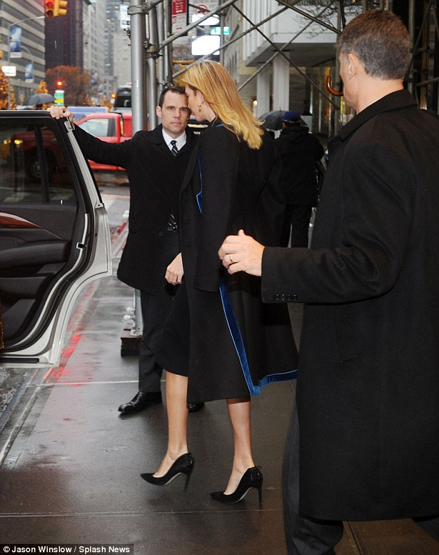 And she's off! Ivanka was flanked by Secret Service agents as she dashed into the SUV waiting outside for her