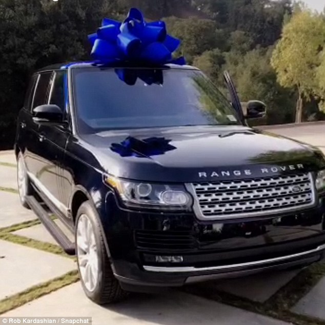 Present time: In multiple updates shared by the couple - who share newborn baby daughter Dream - the top of the range midnight blue car sat on their driveway, complete with a bow
