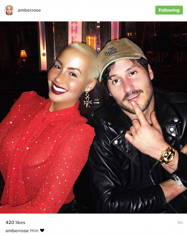 Say it with an emoticon: Amber Rose posted a love heart alongside an Instagram snap with her new beau, Dancing with the Stars professional Val Chmerkovskiy, on Monday