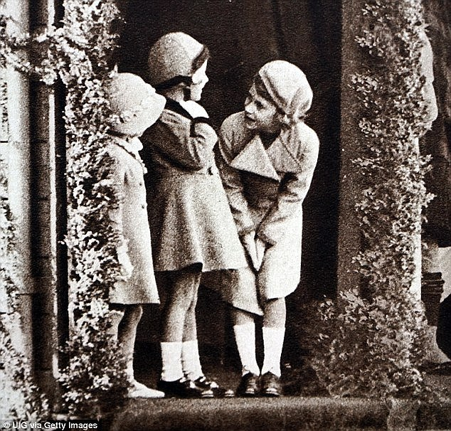 This photograph shows a young Princess Elizabeth, Princess Margaret and their cousin Margaret Elphinstone, later Rhodes