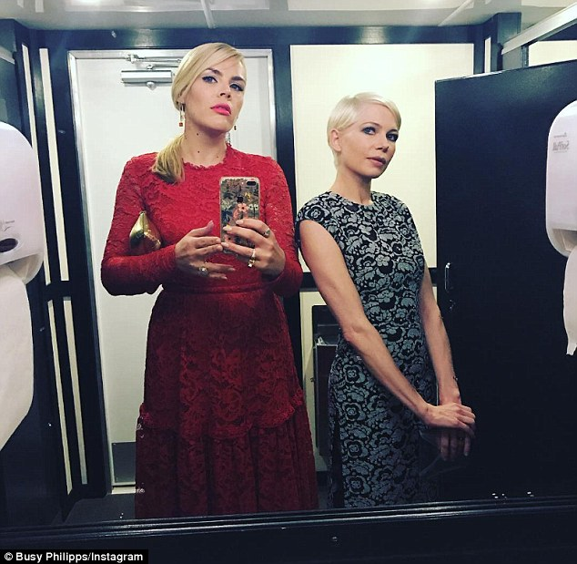 '...Here you go!' Busy shared a photo of herself and Michelle standing in between two hand towel dispensers outside toilet cubicles