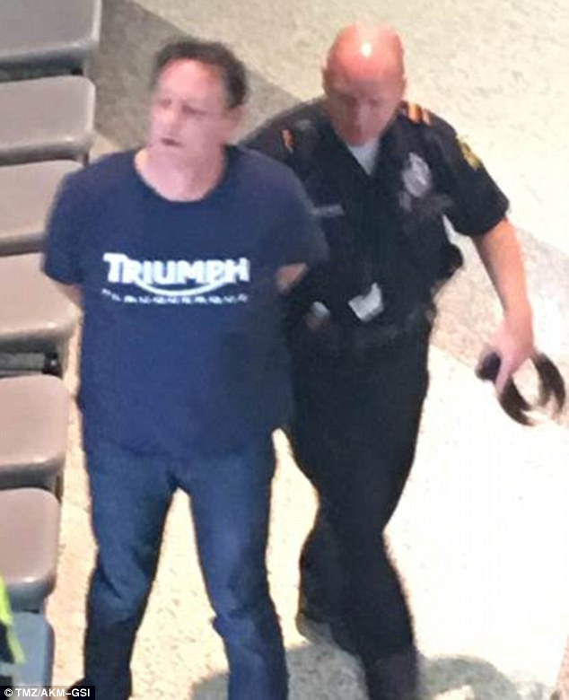 Actor Judge Reinhold, 59, was arrested at Dallas' Love Field airport on Thursday after causing a disturbance in the security line