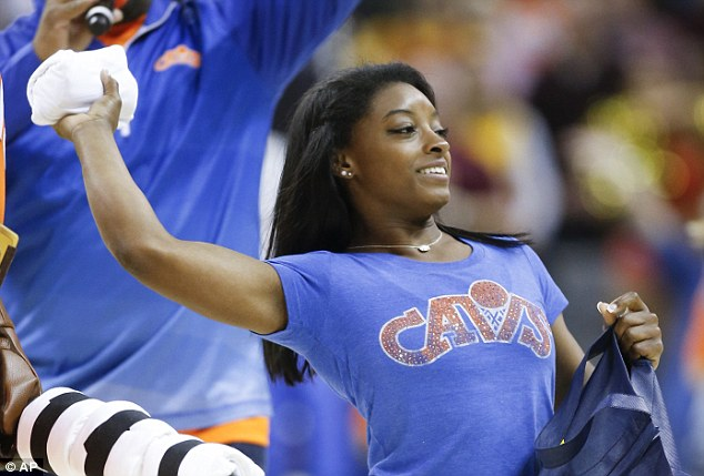 Enjoying the day: Simone took in the game while sporting a blue Cavs T-shirt