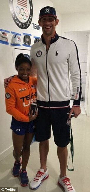Schmoozing about: During the Games, Simone posed with several other athletes who had plenty of height on her