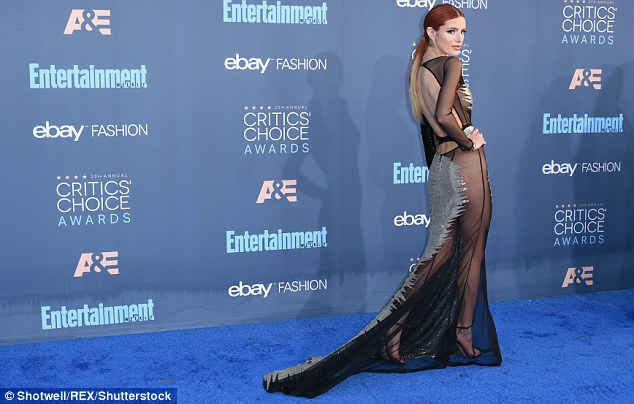 Showstopper: The 19-year-old chose to forgo underwear and a bra in the silver and black look, which had sheer paneling down the sides, over her mid-section and for most of the skirt