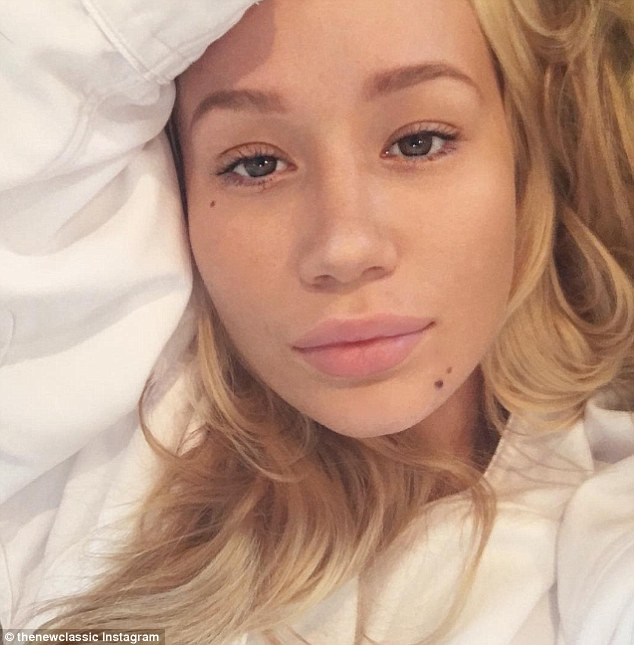 Snap happy: Iggy Azalea went au naturel as she snapped a selfie on Monday. In an up-close shot, the pop star wore no make up as she showed off her flawless complexion