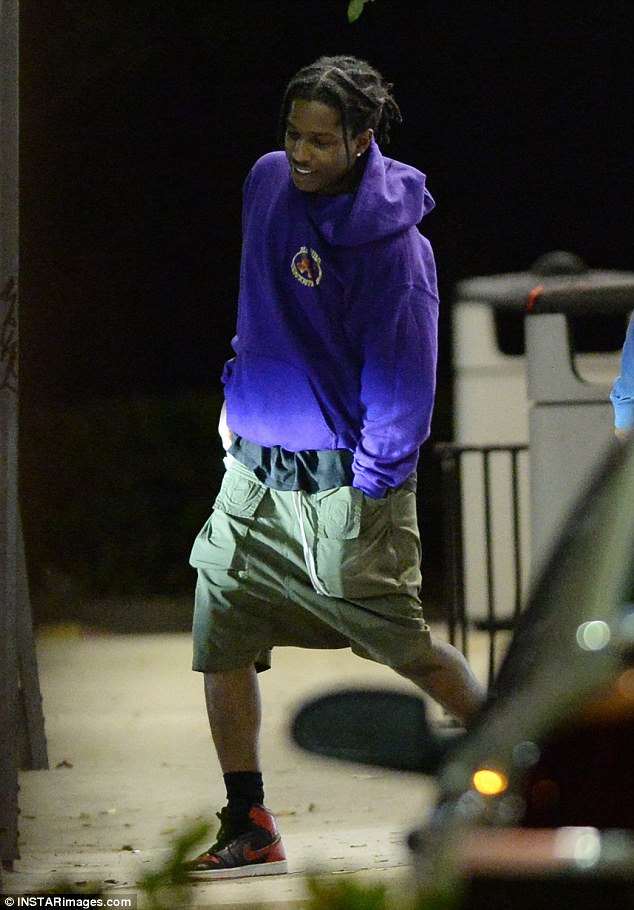 No suit and tie: The musician wore an oversized purple hoodie and cargo shorts with sneakers