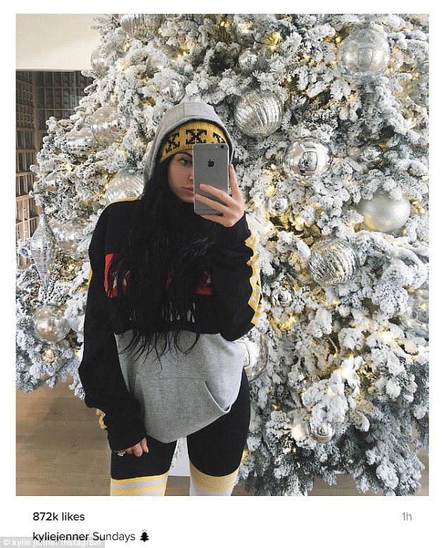 Festive: Also on Sunday, the Keeping Up With The Kardashians castmember also posted a selfie to Instagram showing her standing by her all white Christmas tree