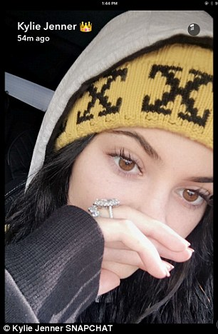 Kitted out with knitted cap: Kylie also shared selfies from inside a car with her left hand in view including her enormous diamond ring on her left hand ring finger