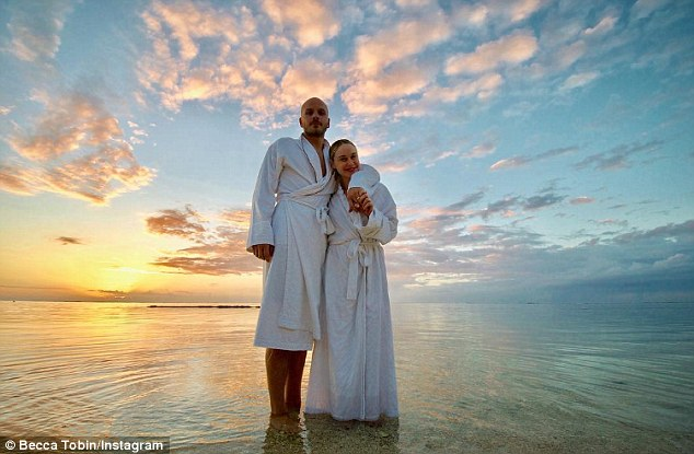 The world is yours: Tobin and her husband Zach Martin looked to be enjoying a luxurious and romantic holiday