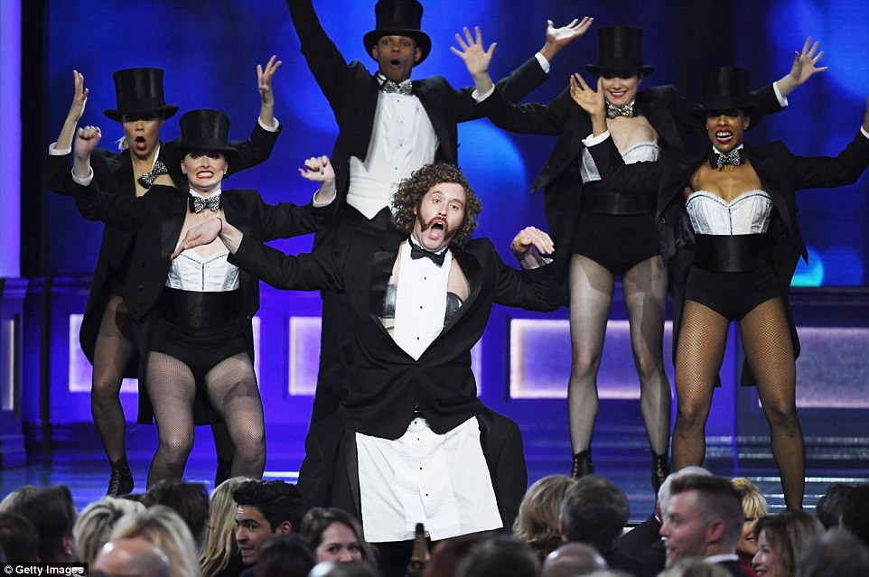 Altogether now: His backing dancers mimicked his moves during his monologue