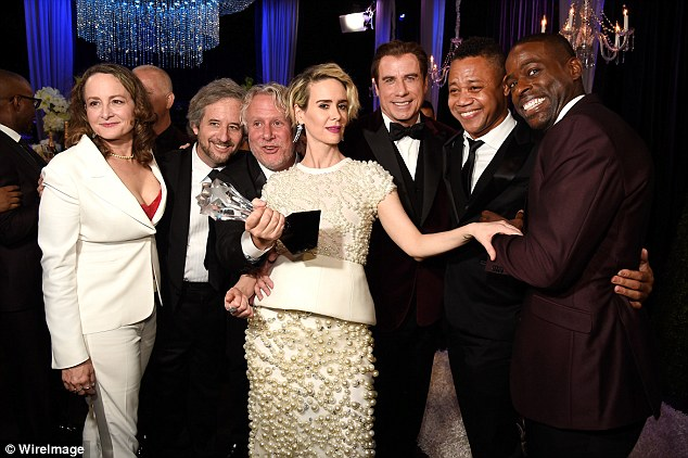 Winners: (L-R) The People V O.J Simpson co-stars Nina Jacobson, Scott Alexander, Larry Karaszewski, Sarah Paulson, John Travolta, Cuba Gooding Jr., and Sterling K. Brown with the award for Best Movie Made for Television or Limited Series