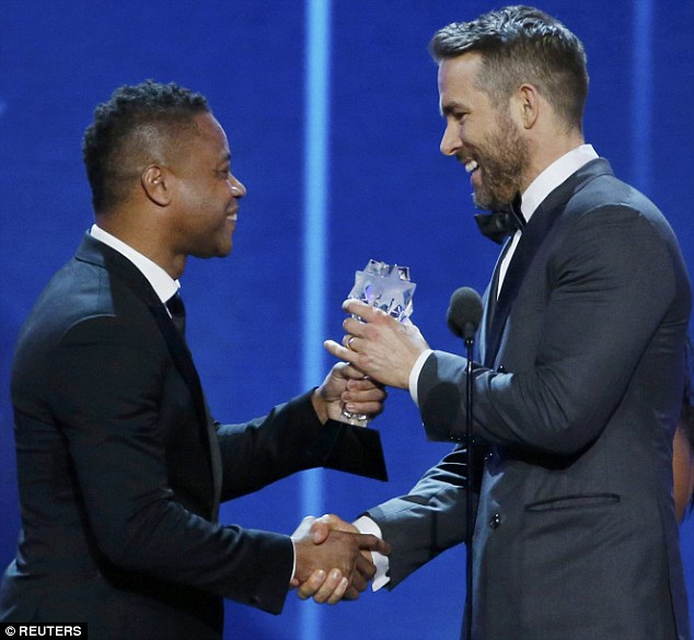 All smiles: The beefcake grinned as he was presented with the Best Comedy Actor award by Cuba Gooding Jr
