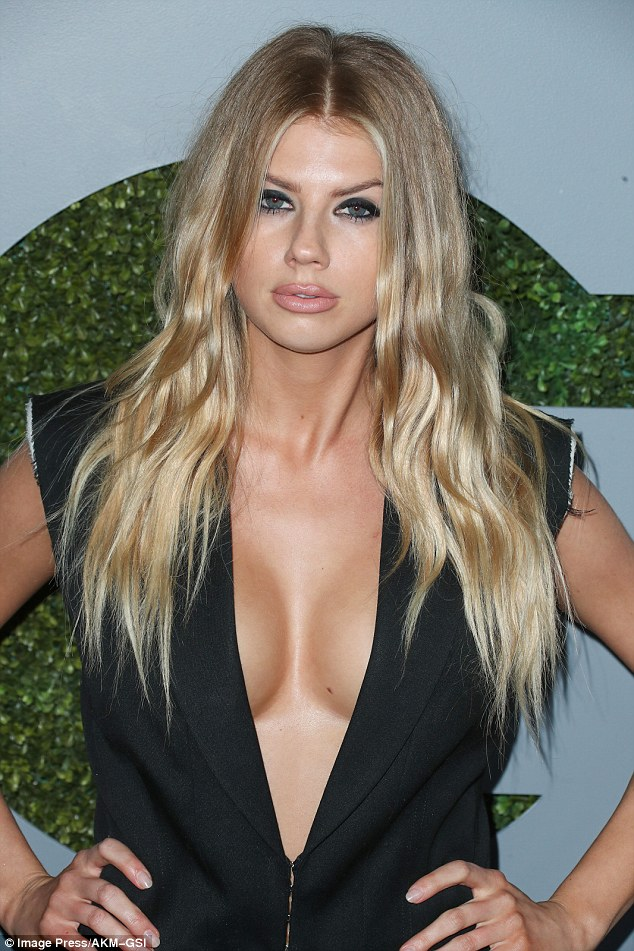 Bust on show: The voluptuous model also caused a stir at the GQ Men of the Year party on Thursday
