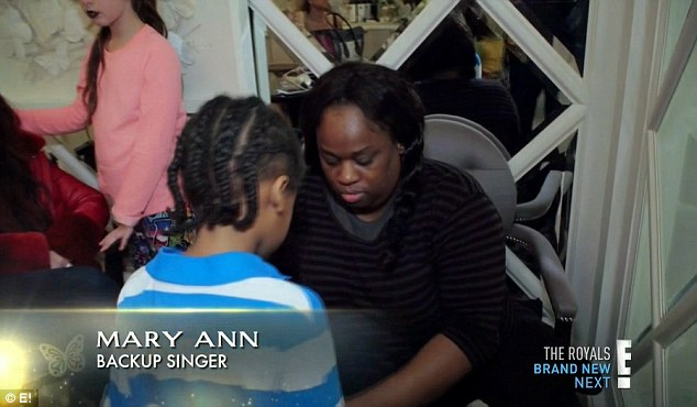 Signer and friend: Mary Ann has known Mariah for years and their children are close