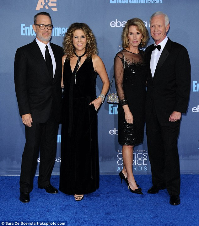 Stellar: Tom Hanks was accompanied to the Critics' Choice Awards by Chesley Sullenberger, 65, his wife Lorrie, and his own spouse Rita Wilson