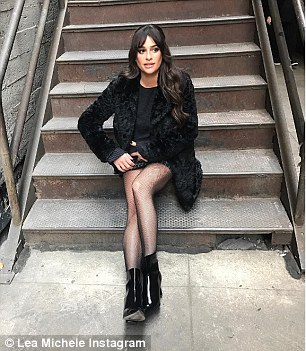Sultry in the stairwell: The fishnets made a second appearance from the cover shoot, this time showing up in a gritty, out door stairwell scene
