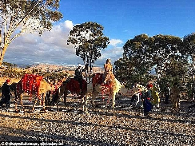 Lavish: The bride and groom rode on camels during their fairytale nuptials