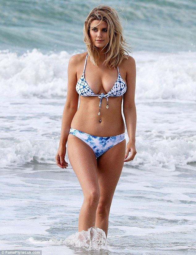 Here she comes: The former Made in Chelsea star, 29, was in fine form after a cooling dip in the ocean as she continues to take advantage of soaring temperatures