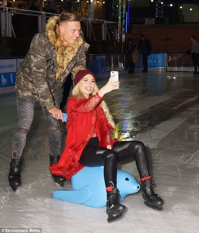 Festive fun: Love Island's Olivia Buckland, 22, and Alex Bowen, 24, looked loved up as they headed to the London's Broadgate Ice Rink for date night on Tuesday