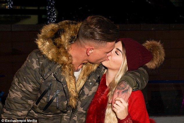 Pucker up: Clearly infatuated with each other, the former Love Island stars took a moment to share a passionate kiss before resuming the skating duties
