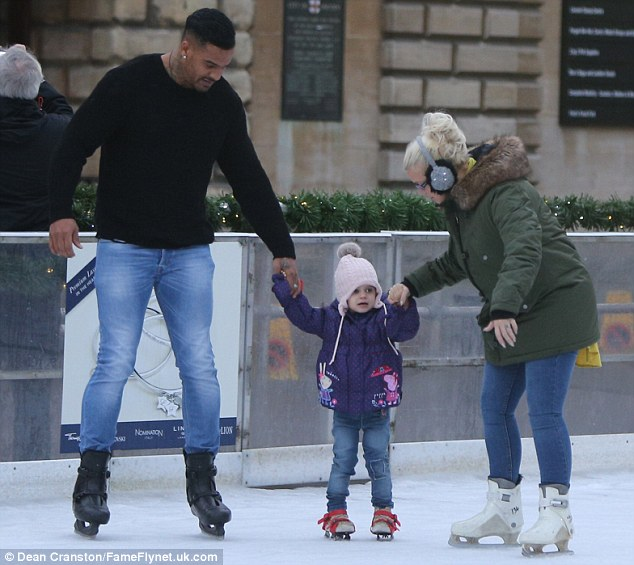 Easy does it: Dylan-Jorge took her first tentative steps on the ice as doting parents Kerry and George Kay held her hands