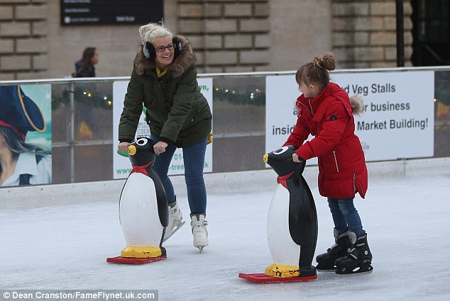 In the swing of it: Kerry was in high spirits as she navigated the rink with daughter Heidi