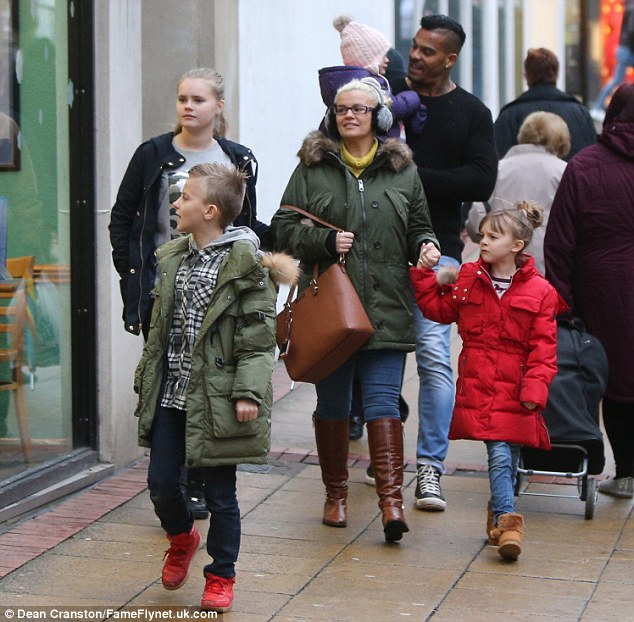 Blending in: The family mingled with fellow shoppers as they browsed the high street