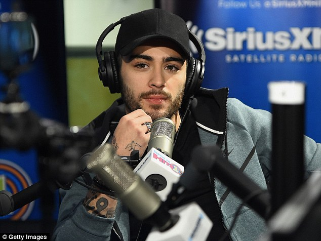 Casual appearance: Zayn sported a baseball cap, black T-shirt and tracksuit for his appearance on the Sirius show