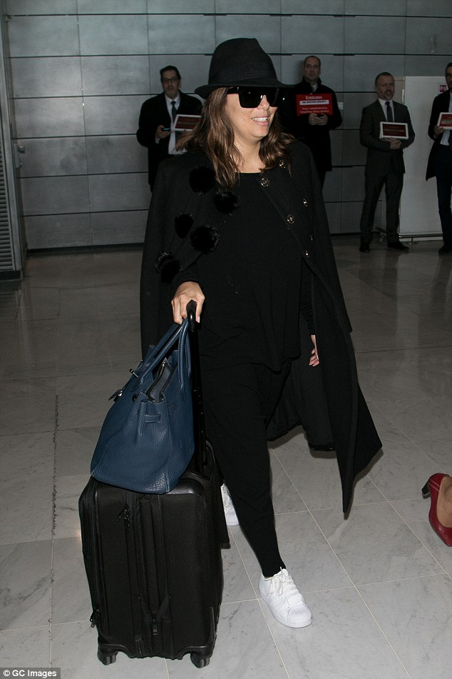 Luggage: Eva squeezed all her glam outfits into one large hardback suitcase while throwing her essentials into a chic blue handbag
