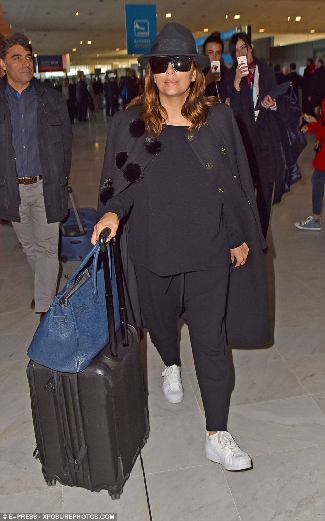 Jet-setter: Eva Longoria, 41, looked stylish as she touched down at Charles de Gaulle Airport in Paris, France, on Wednesday after a whirlwind trip to Dubai
