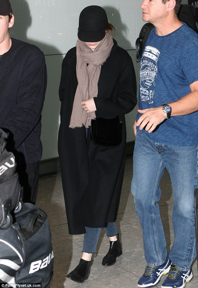 Stylish:Continuing a very low-key look, Emma looked casual in an on-trend oversized winter coat and skinny jeans teamed with stylish black ankle boots