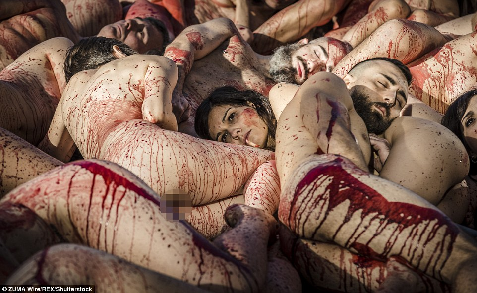 Making a point: Naked animal rights activists covered with fake blood denounce the use of animal skins and fur