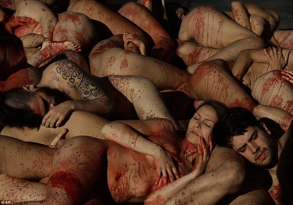 Animal rights activists Anima Naturalis stage a naked protest against the use of leather and fur in the textile industry in Barcelona