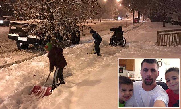 Heartwarming photo shows boys helping man in wheelchair shovel snow in Wisconsin
