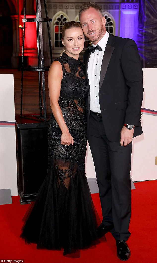 Smitten: Ola posed happily beside her husband James Jordan at the event, who matched his wife's classically chic style in a traditional suit and bow tie