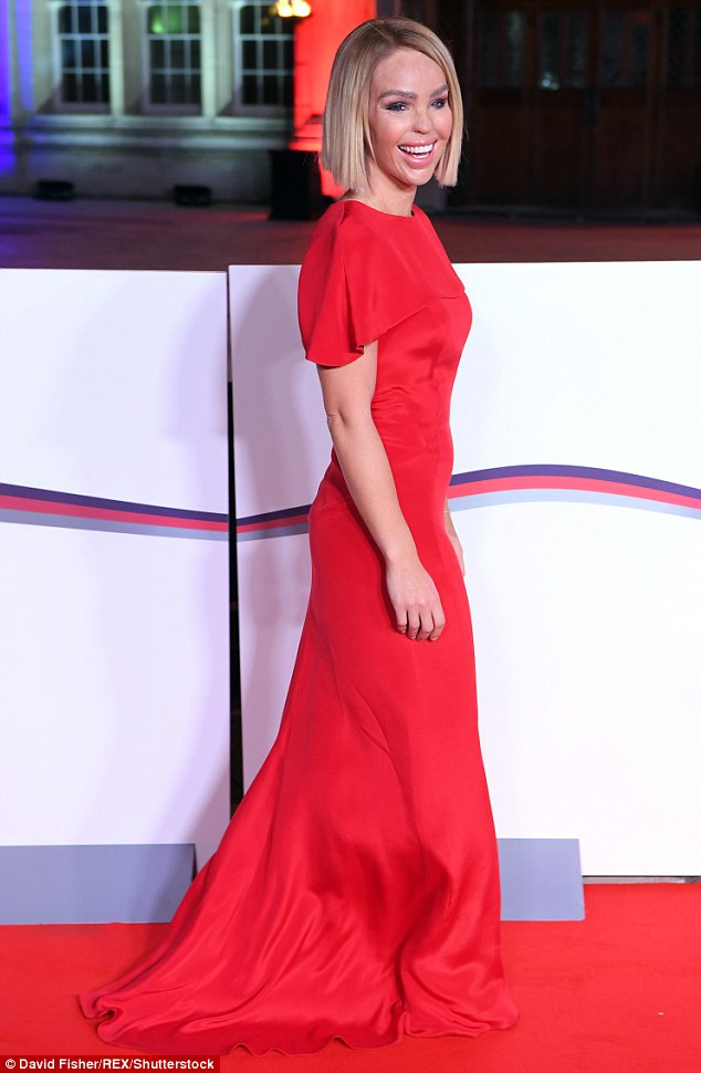 Effortless:The 33-year-old looked stunning in her floor-length scarlet gown, which featured a sophisticated and chic cape sleeve at the top