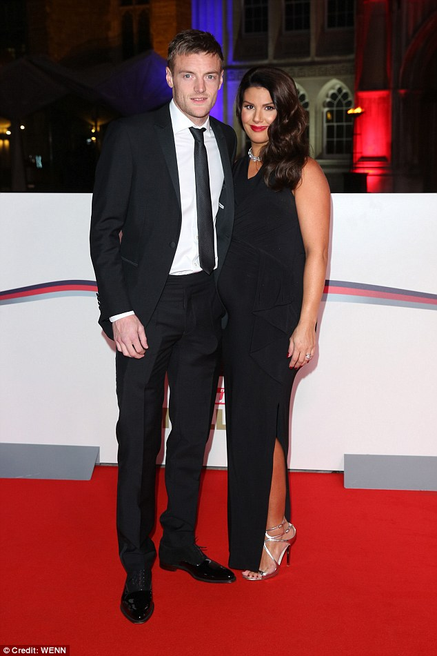 Loved-up:While Katie appeared to leave beloved husband Richard Sutton at home, Rebekah and Jamie Vardy put on a united front as they cosied up together on the carpet