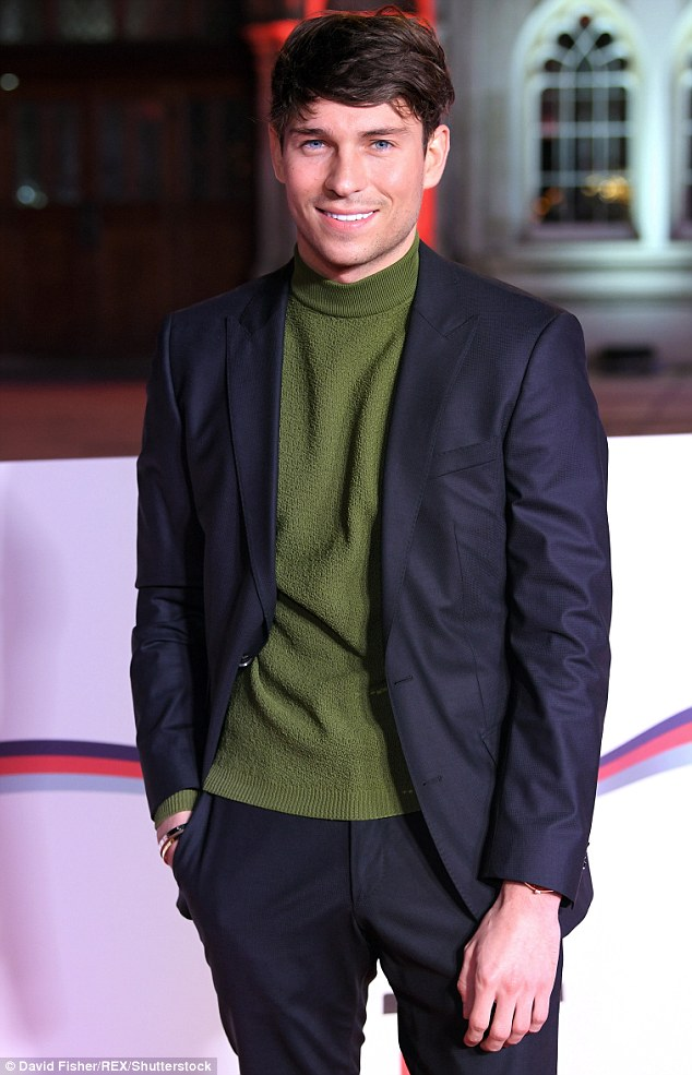 Suave: Representing the boys as the bash was Joey Essex, whoswapped a crisp white shirt for a green roll neck beneath his blazer