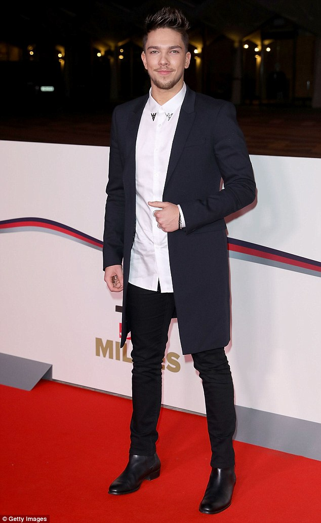 Success story: Meanwhile Matt Terry looked every inch a star as he posed with confidence after his X Factor win