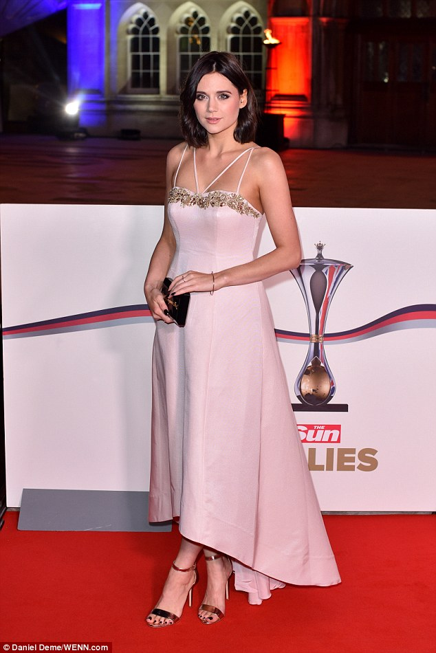 Pretty in pink: Capital FM host Lilah Parsons embodied girly-glamour ina soft pink dress adorned with a shimmering gold floral lining