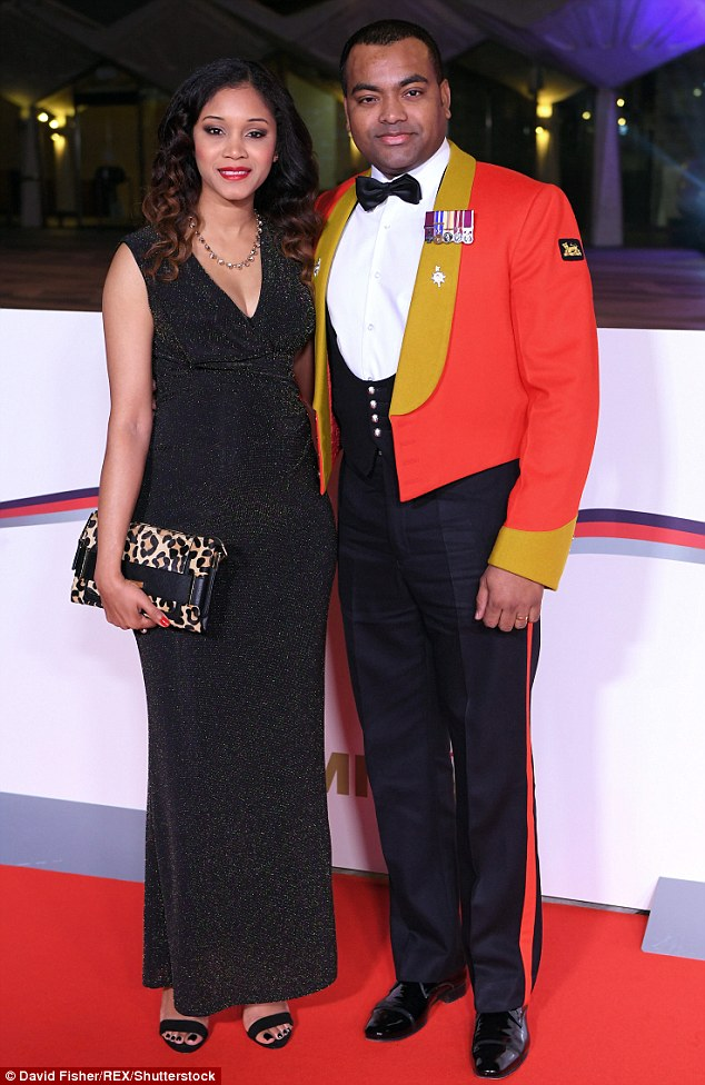 Having a ball: War hero Johnson Beharry and wife Melissa arrived at the honourable event - with Melissa showing off her baby bump in a shimmering tight-fitting dress