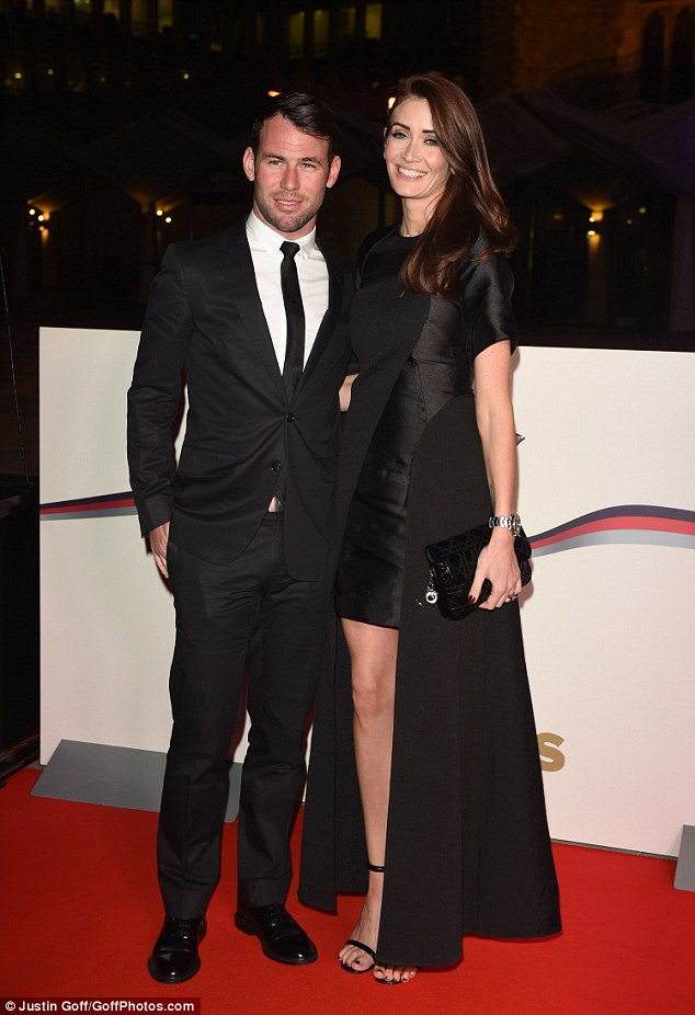 Good looking pair: Another sportsperson came in the form of road racing cyclist Mark Cavendish, who wowed in a sharp black suit while his stunning wife Peta Todd flashed her legs in a stylish black gown