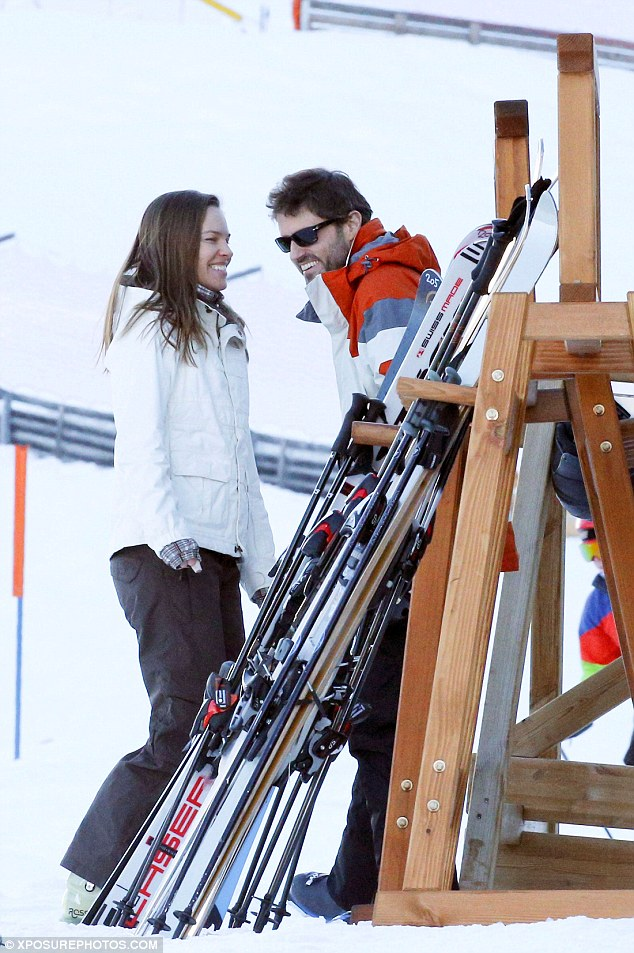 Snow joke: The couple laughed as they stood next to a ski stand