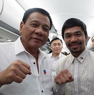 Manny Pacquiao poses with controversial Philippines president Rodrigo Duterte who