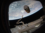 This photo provided by NASA TV shows a Japanese cargo ship before it arrives with Christmas gifts to the International Space Station on Tuesday, Dec. 13, 2016. The capsule ¿ called Kounotori, or white stork ¿ contains nearly 5 tons of food, water, batteries and other supplies. NASA said there also are Christmas presents for the two Americans, three Russians and one Frenchman on board. (NASA TV via AP)